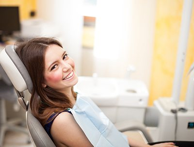 A woman visiting the dentist for a dental cleaning.