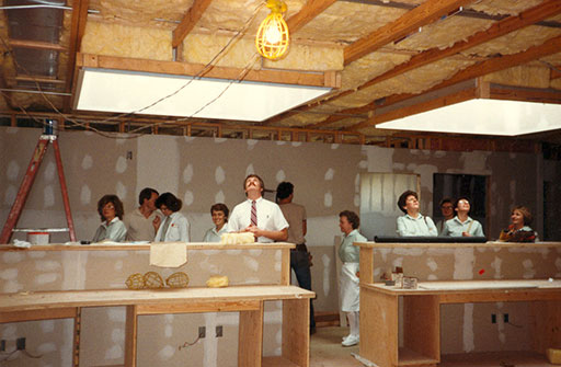 Dentist and his team looking around the new offie in 1984