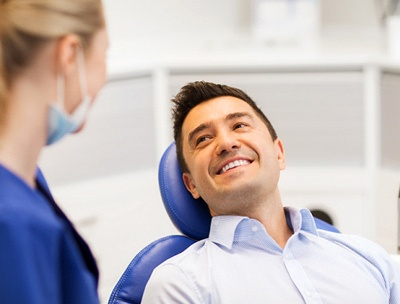 A male patient smiling at the dental hygienist