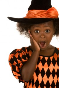 The family dentist Toledo trusts talks Halloween candy and cavities with this surprised child dressed as a witch