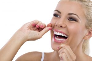 Your dentist in Toledo recommends flossing.