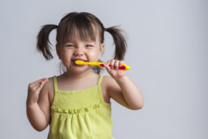 Brushing and flossing can be fun for your child! Your family dentist in Toledo shows you how.