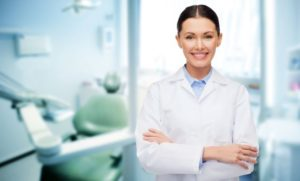 Dental professional smiling can