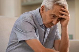an elderly man who is showing signs of forgetfulness