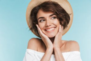Smiling woman with summer hat